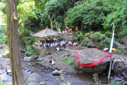 Hindu ceremony in progress at the waterfall