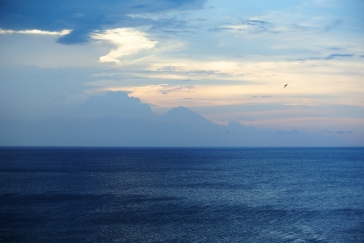Sunset at Mangist beach with Mt Agung ( on Bali island) in the background