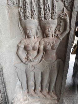 """2 of the numerous """"apsaras"""" ( celestial nymphs) carvings"""