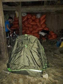 Tent in their living room -cum- grain store